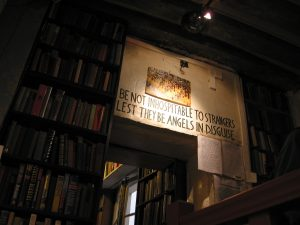 "A sign above a door in the Shakespeare Bookshop in Paris, ""Be not inhospitable to strangers lest they be angels in disguise"""