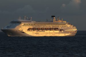 Pacific Dawn off Caloundra in the evening with golden sun shining off her side